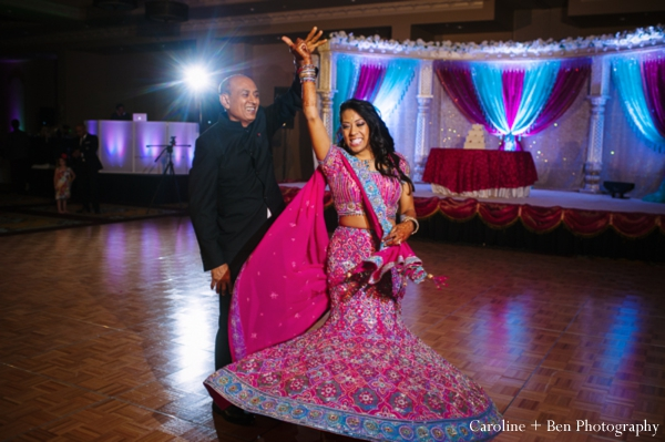 Indian wedding reception dancing bride father
