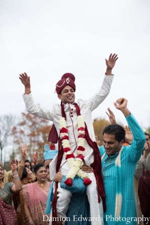 Indian wedding baraat groom celebrating jai mala