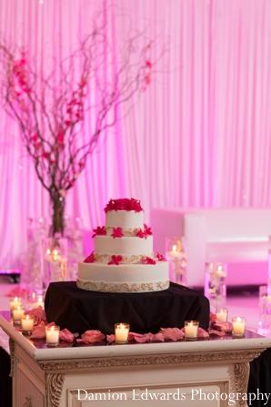 Indian wedding cake lighting reception