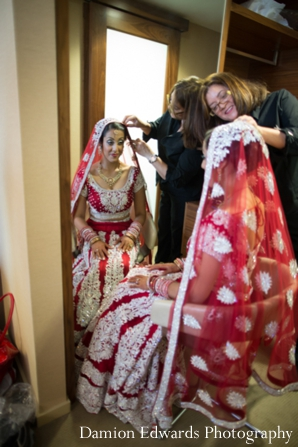 Indian wedding bride getting ready traditional lengha in Jersey City, New Jersey Indian Wedding by Damion Edwards Photography