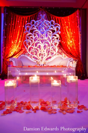indian wedding reception,reception decor,Damion Edwards Photography,reception lighting inspiration,reception design,colorful reception seating,bride and groom lounge