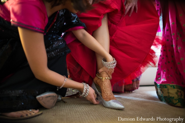 red,bridal fashions,indian wedding bride,bridal lengha,traditional bridal dress,inspiration for bridal dress,Damion Edwards Photography,bride gets ready for ceremony