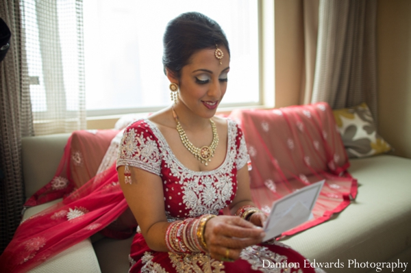 red,indian wedding bride,bridal lengha,traditional bridal dress,inspiration for bridal dress,Damion Edwards Photography,bride gets ready for ceremony