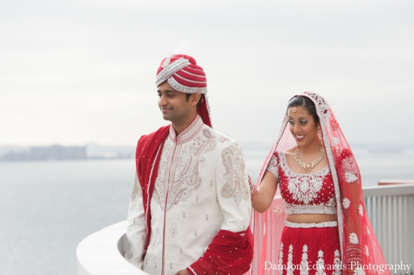 Featured Indian Weddings,red,sherwani,indian wedding portraits,outdoor portraits,first look portraits,bride and groom portraits,Damion Edwards Photography,traditional ceremony dress,bride lengha