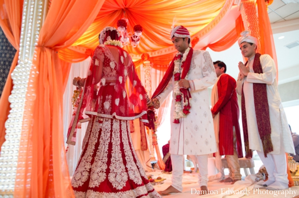 red,orange,indian wedding ceremony,indian wedding mandap,ceremony mandap,Damion Edwards Photography,fabric draped mandap,decor ideas for wedding ceremony
