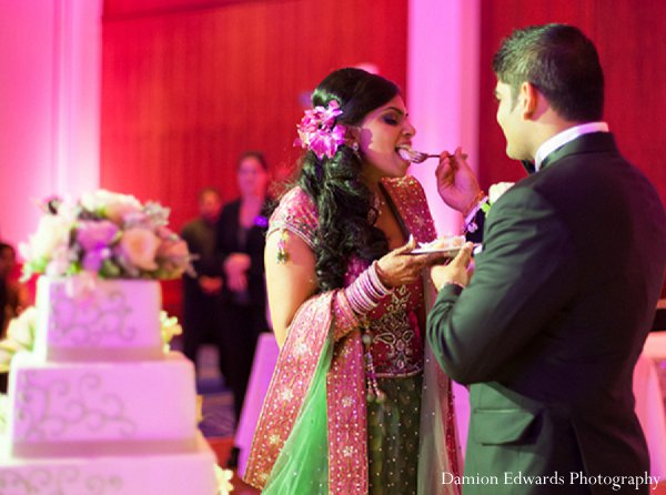 Indian wedding cake treats bride groom in New Brunswick, NJ Indian Wedding by Damion Edwards Photography
