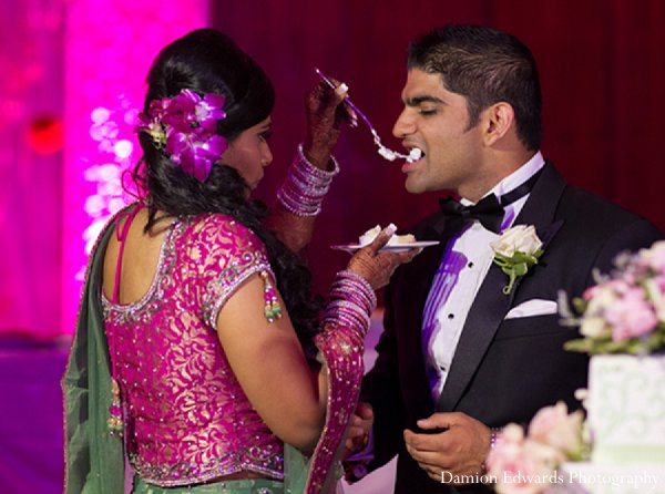 Indian wedding groom bride cake reception in New Brunswick, NJ Indian Wedding by Damion Edwards Photography