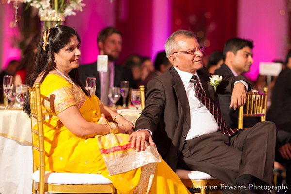 Indian wedding reception guests sari yellow in New Brunswick, NJ Indian Wedding by Damion Edwards Photography