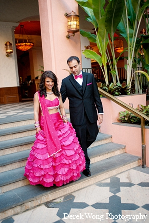 Indian wedding bride groom reception outfits hot pink lengha in Kailua, Hawaii Indian Wedding by Derek Wong Photography