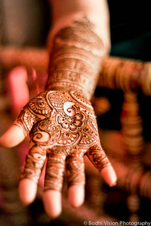 Indian wedding mehndi ceremony bride artist
