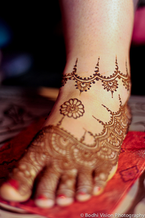 Indian wedding mehndi ceremony bride