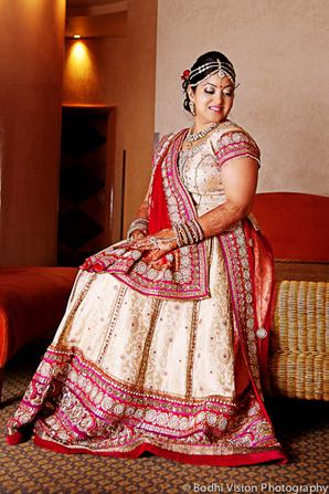 Indian wedding sari red cream bride
