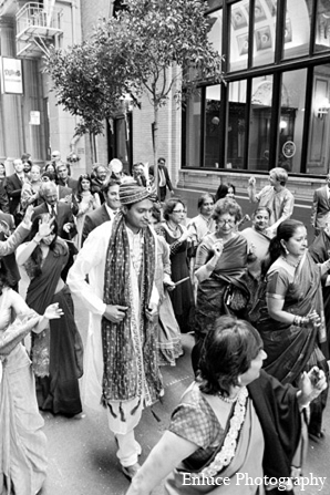 An Indian wedding takes place in the city of San Francisco. The bride and groom wed in a traditional Hindu ceremony and have a reception in an elegant ballroom.