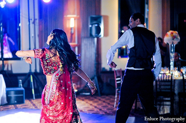 Indian wedding reception bride groom dance pink lengha in San Francisco, California Indian Wedding by Enluce Photography