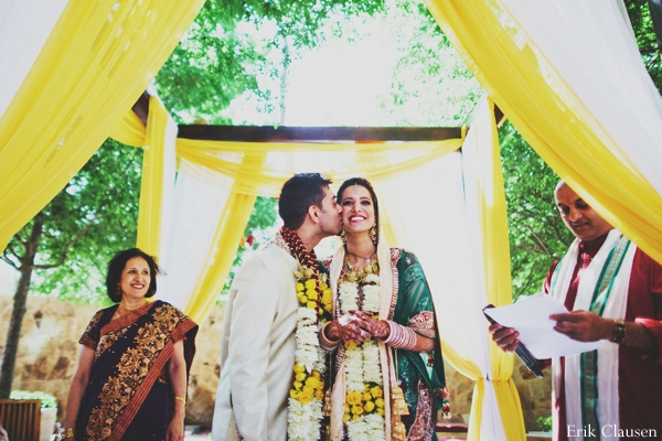 yellow,green,ceremony,indian wedding ceremony,traditional customs and rituals,indian wedding jai mala,bride and groom at wedding ceremony,Erik Clausen,ceremonial traditions at indian wedding,floral garland necklace