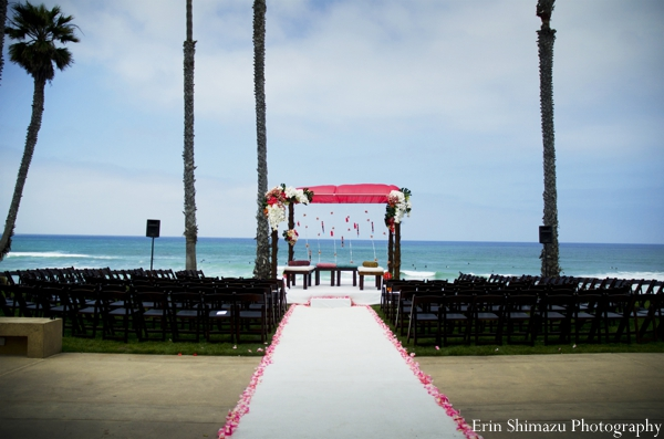 Indian wedding ceremony beach outdoors mandap in Picturesque Indian Wedding + Garba by Erin Shimazu Photography, San Diego, California