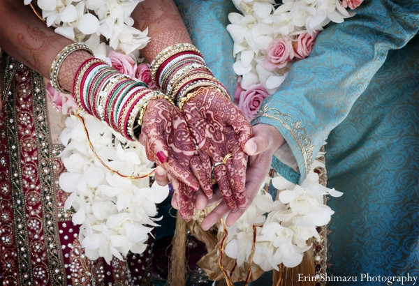 Indian wedding ceremony traditional mehndi in Picturesque Indian Wedding + Garba by Erin Shimazu Photography, San Diego, California