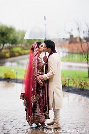 Indian-wedding-portrait-groom-bride-kiss-umbrella