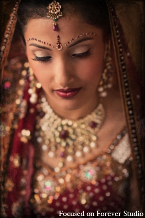 Featured Indian Weddings,red,gold,cream,bridal jewelry,indian wedding makeup,indian bridal makeup,indian bride makeup,Focused On Forever Studio