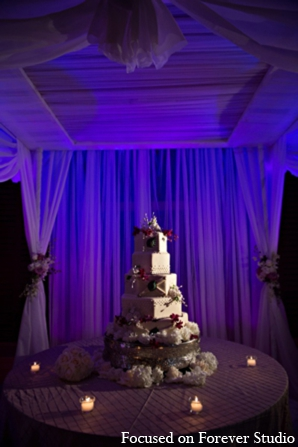 Indian wedding reception lighting cake in Boca Raton, Florida Indian Wedding by Focused on Forever Studio