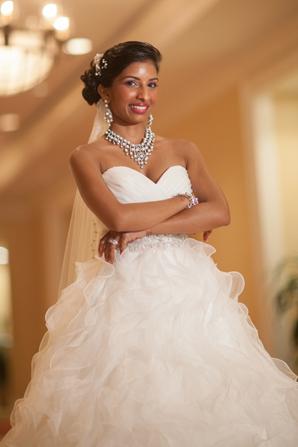 Indian wedding bride white dress in Orlando, Florida Fusion Wedding by Garrett Frandsen