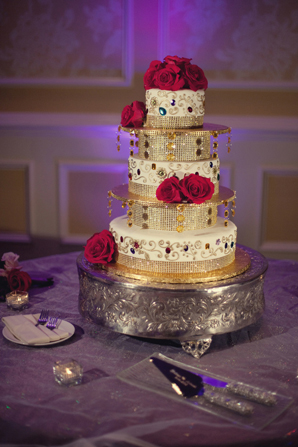 Indian wedding cake decor floral in Orlando, Florida Fusion Wedding by Garrett Frandsen