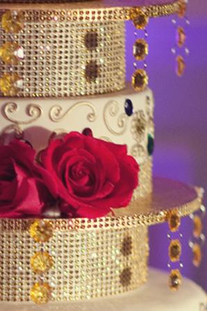 Indian wedding cake decor jewels in Orlando, Florida Fusion Wedding by Garrett Frandsen