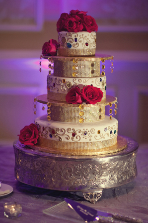 Indian wedding cake red gold white in Orlando, Florida Fusion Wedding by Garrett Frandsen