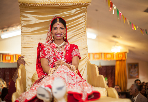 Indian wedding dooli bride in Orlando, Florida Fusion Wedding by Garrett Frandsen