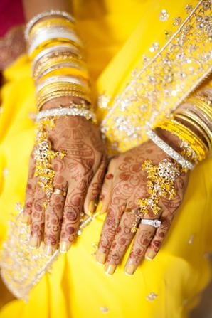 Indian wedding jewelry yellow in Orlando, Florida Fusion Wedding by Garrett Frandsen