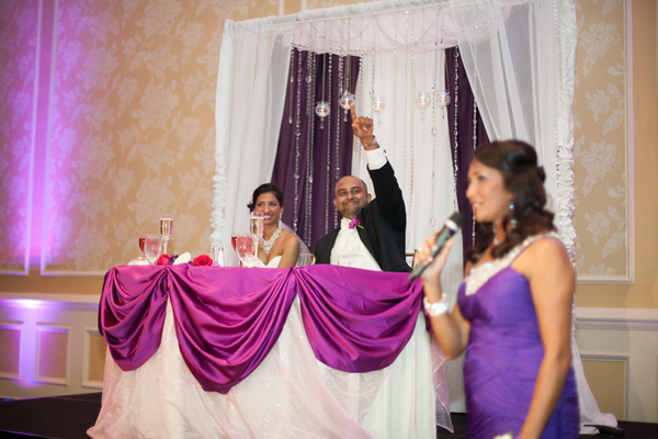 Indian wedding reception bride groom toast in Orlando, Florida Fusion Wedding by Garrett Frandsen