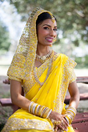 Indian wedding traditional hair makeup veil in Orlando, Florida Fusion Wedding by Garrett Frandsen