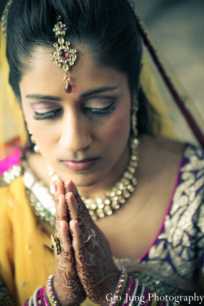 Indian wedding bride prep traditional dress in Agawam, Massachusetts Indian Wedding by Gio Jung Photography