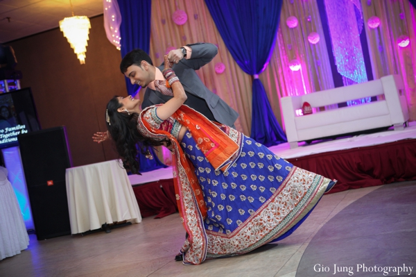 Indian wedding reception bride groom dancing in Agawam, Massachusetts Indian Wedding by Gio Jung Photography