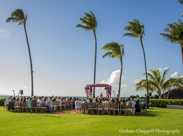 Indian wedding ceremony mandap in Lahaina, HI Indian Wedding by Graham Chappell Photography