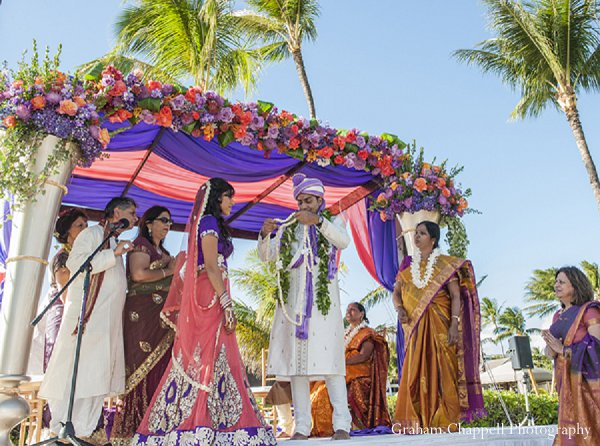 Indian wedding mandap ceremony florals in Lahaina, HI Indian Wedding by Graham Chappell Photography