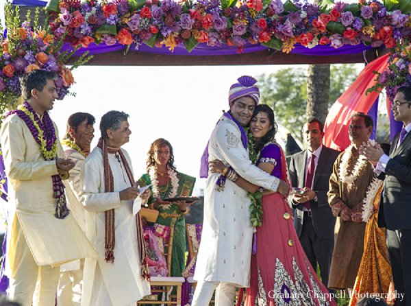 Indian wedding mandap floral decor in Lahaina, HI Indian Wedding by Graham Chappell Photography