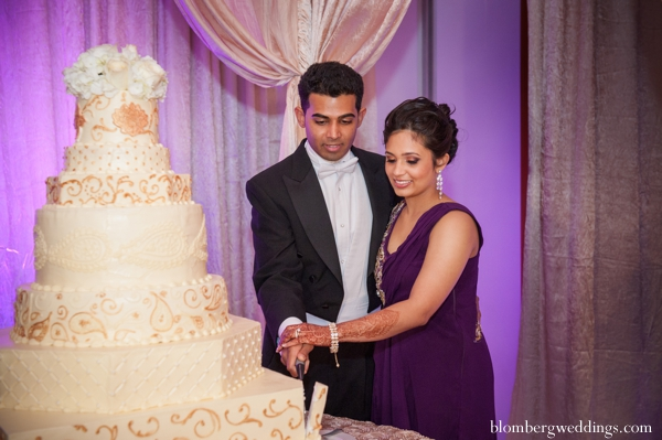 Indian wedding reception cake bride groom in Dallas, Texas Indian Wedding by Greg Blomberg