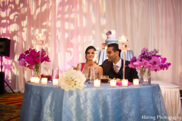 light blue,indian wedding reception,indian wedding reception lighting,indian bride and groom reception,haring photography,reception sweethearts table