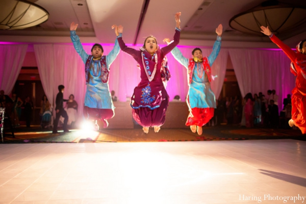 red,teal,hot pink,indian wedding lighting,indian wedding reception,entertainment,indian wedding dance,haring photography,bollywood dancing entertainment