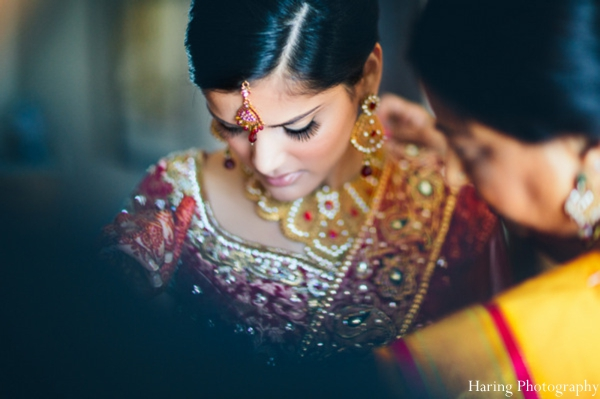 Indian wedding bride maharani getting dressed in Fort Lauderdale, Florida Indian Wedding by Haring Photography