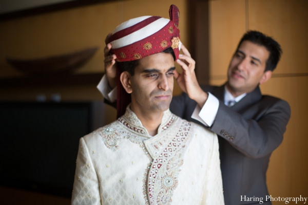 Indian wedding groom getting dressed sherwani in Fort Lauderdale, Florida Indian Wedding by Haring Photography