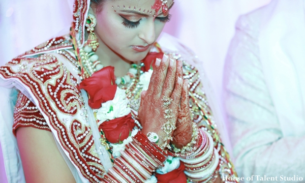 The bride and groom at the Indian wedding ceremony where traditional rituals and customs are performed.