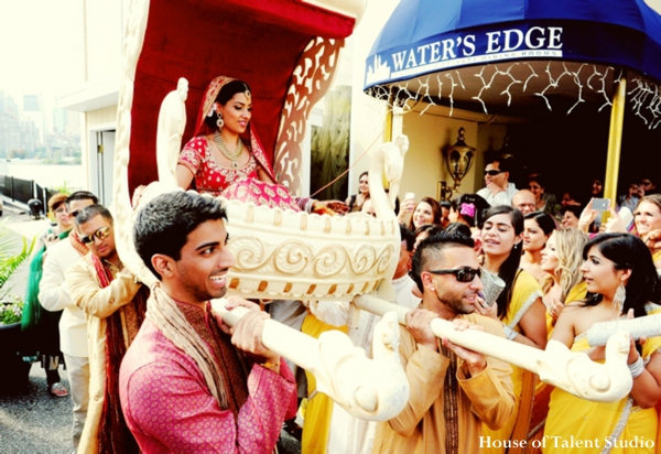 Indian-wedding-bride-enters-ceremony-palanquin