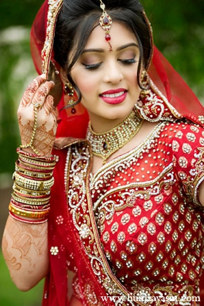 Indian bride wedding outfit red lengha makeup hair jewelry fashion in Temple, Texas Indian Wedding by Humza Yasin Photography
