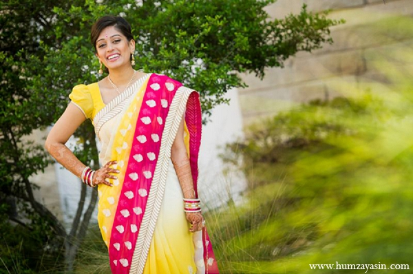 Indian wedding bridal pithi outfit yellow sari hot pink in Temple, Texas Indian Wedding by Humza Yasin Photography