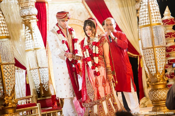 Indian wedding bride groom hindu ceremony traditional red sari mandap in Temple, Texas Indian Wedding by Humza Yasin Photography