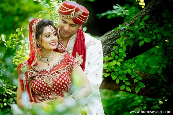 Indian wedding bride groom portraits red lengha outdoor in Temple, Texas Indian Wedding by Humza Yasin Photography