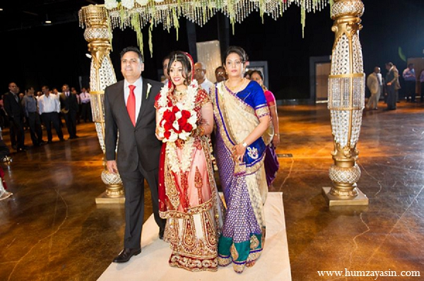 Indian wedding ceremony bride family red lengha in Temple, Texas Indian Wedding by Humza Yasin Photography
