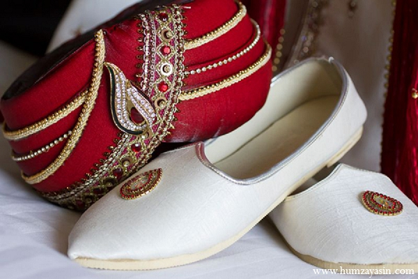 Indian wedding groom outfit white khusse red paag in Temple, Texas Indian Wedding by Humza Yasin Photography